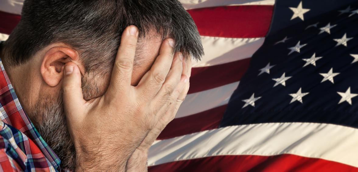 veteran in front of American flag, distressed